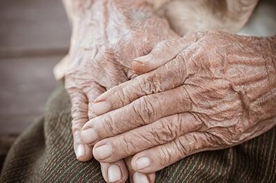 bigstock-Hands-Asian-Elderly-Woman-Gras-238196167